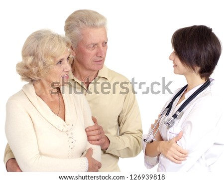 Beautiful young nice Nurse with elderly patient on a light background - stock photo