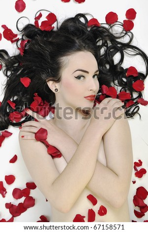beautiful young nude woman with roses isolated on white representing beauty concept - stock photo