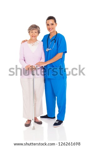 beautiful young nurse and senior woman isolated on white - stock photo