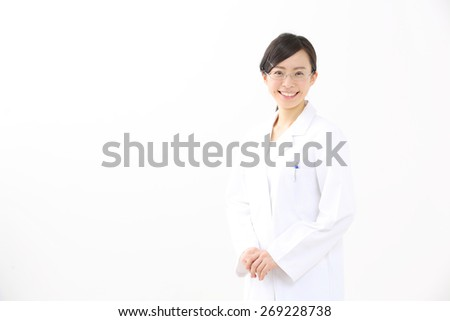 Beautiful young nurse on white background - stock photo