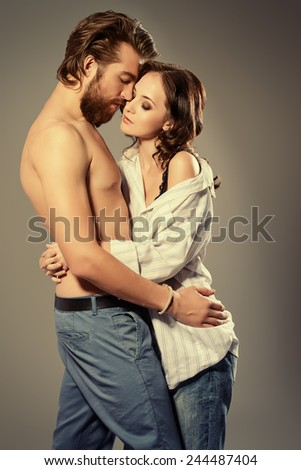 Beautiful young people in love tenderly hugging. Love concept.