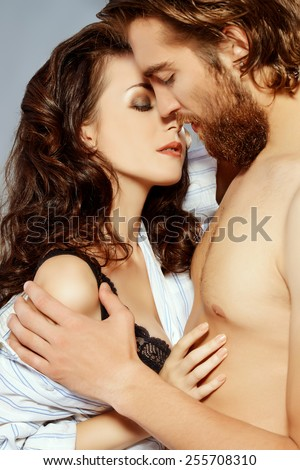 Beautiful young people in love tenderly hugging. Love concept. - stock photo