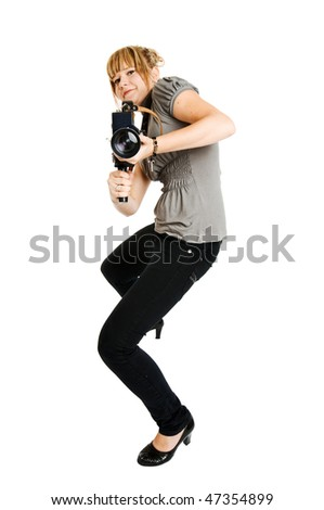 Beautiful young photographer or videographer on plain background - stock photo