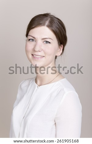 Beautiful young positive caucasian brunette businesswoman in white shirt looking at camera. Business and causal natural real people concepts. - stock photo