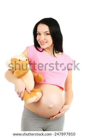 Beautiful young pregnant with baby toy isolated on white - stock photo