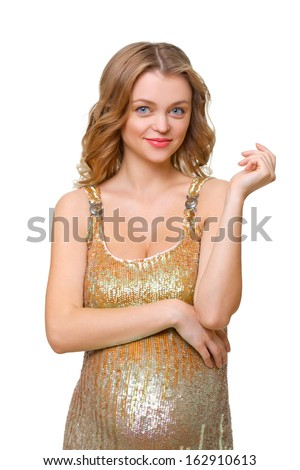 Beautiful young pregnant woman in a gold dress isolated on white background