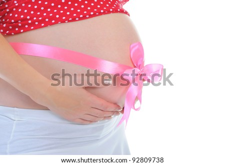 beautiful young pregnant woman. Isolated on white background - stock photo