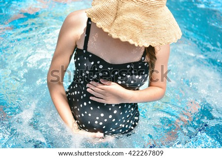 Beautiful young pregnant woman sitting swimming stock photo 422267809 shutterstock for Girl pregnant in swimming pool