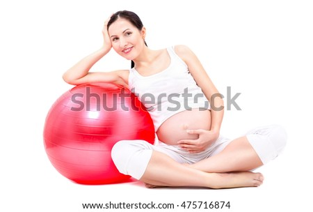 Beautiful young pregnant woman sitting with fitball isolated on white background
