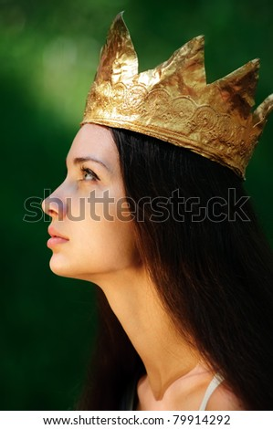 beautiful young queen in forest - stock photo