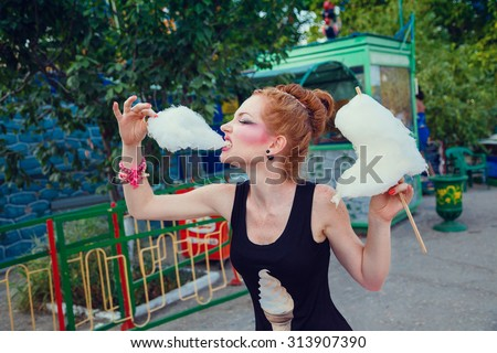 beautiful young redhead woman in funny dress outdoor in amusement park summer day - stock photo