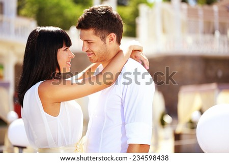 Beautiful young romantic couple outdoors - stock photo