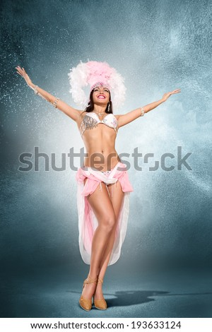 Beautiful young samba dancer in pink stage costume - stock photo
