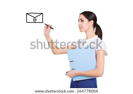 Beautiful young secretary in formalware with documents and pen writing an email with creative ideas - stock photo