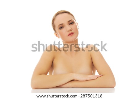 Beautiful young sensual spa woman by a desk.