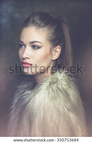 beautiful young sensual woman with artificial fur  portrait, studio shot