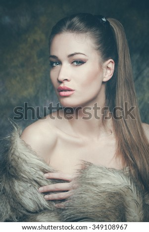 beautiful young sensual woman with artificial fur  portrait, studio shot, front view