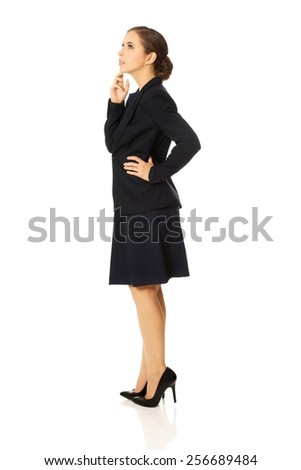 Beautiful young serious thoughtful businesswoman - stock photo