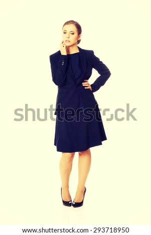Beautiful young serious thoughtful businesswoman - stock photo