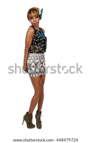 Beautiful young sexy black African American woman in a dress and heels posing - stock photo