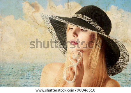 Beautiful young sexy blonde woman in sun hat old portrait - stock photo