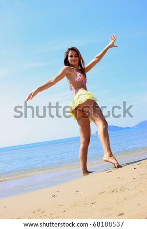 Beautiful young sexy Brazilian model by the sea - stock photo