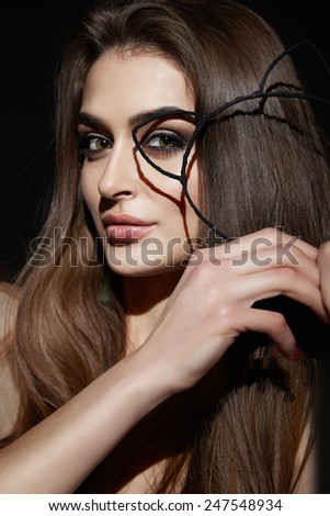 Beautiful young sexy brunette woman with bright evening make-up perfect smooth skin cosmetics cream face care, jewelry, beauty salon, magazine, close-up portrait with ears - stock photo