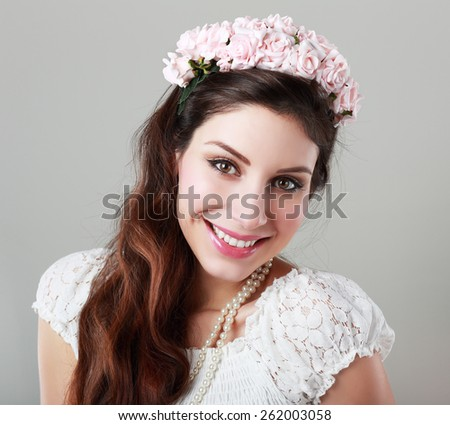 beautiful young sexy elegant happy smiling woman with red lips, with pink flowers in her hair, the way for the bride at a wedding in boho style - stock photo