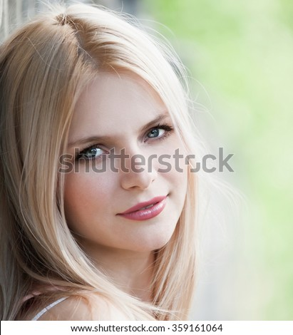 Beautiful young sexy elegant woman face, has happy fun blue eyes, blonde nature hair, pink smiling lips, white teeth. Pure makeup. White background.  - stock photo