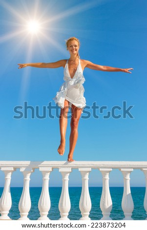 Beautiful young sexy fashion model by the sea in Greece - stock photo