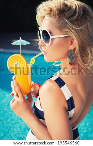 Beautiful, young, sexy girl with a summer cocktail - stock photo