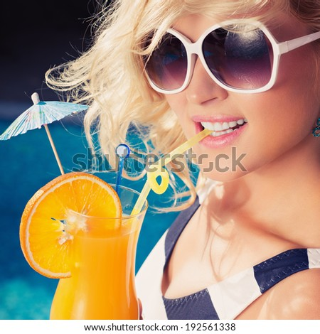 Beautiful, young, sexy girl with a summer cocktail. Photo in color style instagram filters  - stock photo