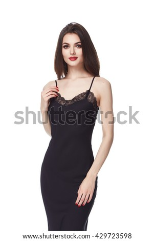 Beautiful young sexy girl with long brunette hair with a bright evening make-up perfect summer tan thin figure dressed in black silk dress with lace and high heels shoes businesswoman casual clothes - stock photo
