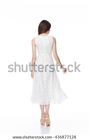 Beautiful young sexy girl with long brunette hair with a bright evening make-up perfect summer tan thin figure dressed in white silk dress with lace and high heels shoes businesswoman casual clothes - stock photo