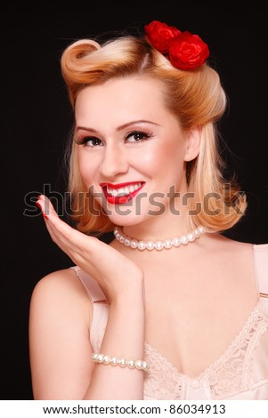 Beautiful young sexy laughing woman with vintage make-up and hairstyle - stock photo