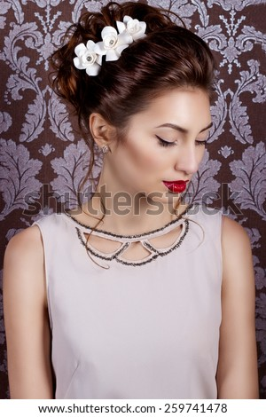 beautiful young sexy sweet girl with large red lips in wedding white wreath on the head with beautiful wedding hairstyle. The image of a wedding, salon hair and makeup - stock photo
