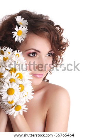 Beautiful young sexy woman closeup with white camomile