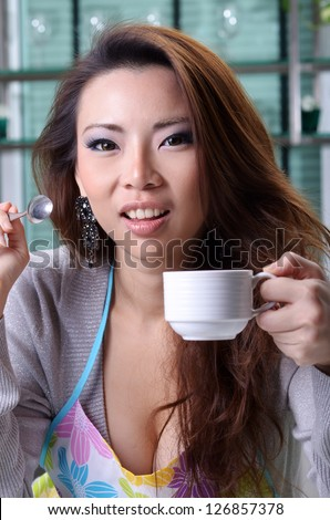 Beautiful young sexy woman drinks hot coffee at home