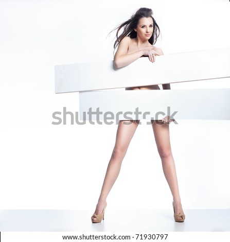Beautiful young sexy woman holding empty white board - stock photo