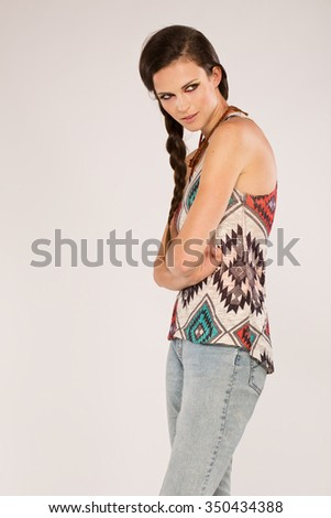 Beautiful young sexy woman in a colorfull outfit posing against a white wall - stock photo