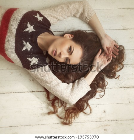 beautiful young sexy woman on the floor - stock photo