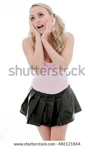 Beautiful Young Shocked and Surprised Caucasian Woman Against a White Background Wearing a Mini Skirt and a Pink Top