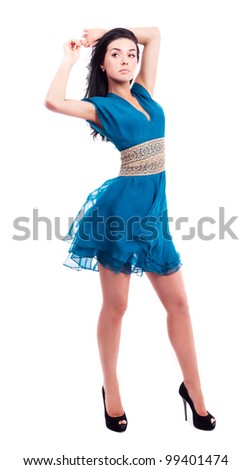 beautiful young slim brunette woman wearing a blue dress isolated on white