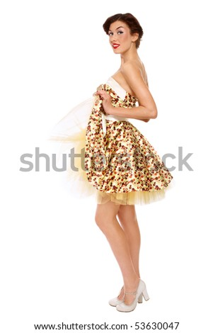 Beautiful young slim girl in stylish dress and shoes over white background