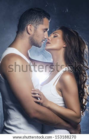 Beautiful young smiling couple in love embracing kissing  - stock photo
