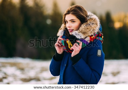 Beautiful Young Smiling Girl in her Winter Warm Clothing - stock photo