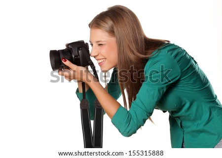 beautiful young smiling girl photographing with her ??camera - stock photo