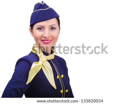 Beautiful young  smiling stewardess in uniform isolated on a white background - stock photo