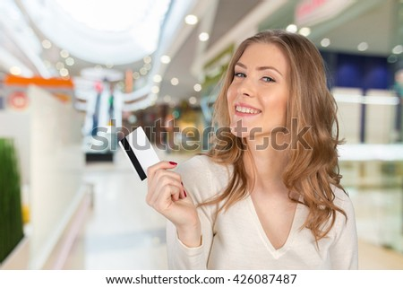 beautiful young smiling woman holding credit card