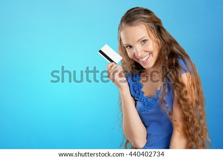 beautiful young smiling woman holding credit card - stock photo